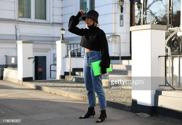 Aylin Koenig wearing Balenciaga shoes Stradivarius jeans Orseund Iris sweater Prada bag on February 18 2019 in Hamburg Germany