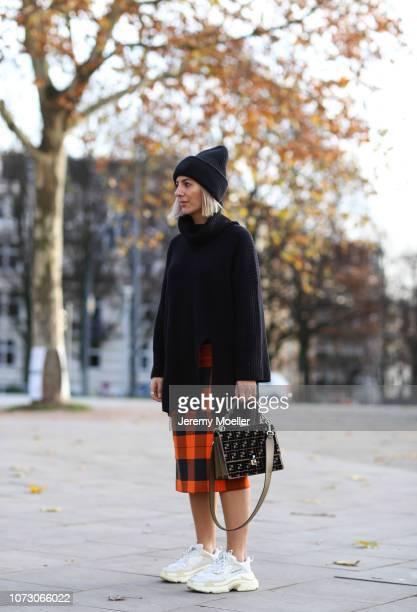 Aylin Koenig wearing Balenciaga Triple S Acne Studios hat Zara skirt HM sweater Max Mara coat and Fendi bag on November 26 2018 in Hamburg Germany