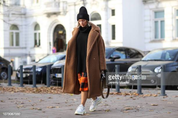 Aylin Koenig wearing Balenciaga Triple S Acne Studios hat Zara skirt HM sweater Max Mara coat and Fendi bag on November 26 2018 in Hamburg Germany