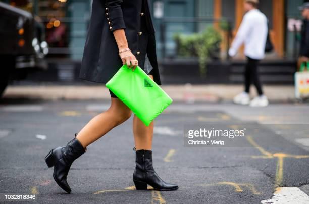 Aylin Koenig wearing boots Dior Prada clutch Balenciaga tshirt Balmain blazer Dior necklace Dolce Gabbana sunglasses is seen during New York Fashion...