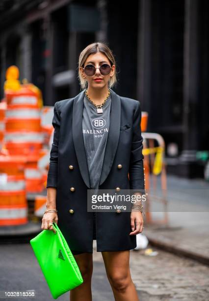 Aylin Koenig wearing boots Dior Prada clutch Balenciaga tshirt Balmain blazer Dior necklace Dolce Gabbana sunglasses is seen during New York Fashion...