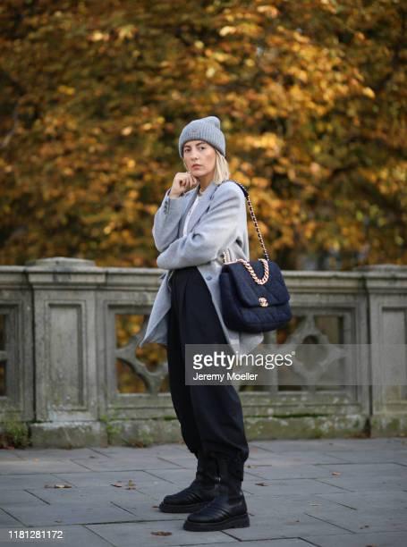 Aylin Koenig wearing Bottega Veneta boots, Chanel bag, Zara pants, By Aylin Koenig blazer and acne studios hat on October 14, 2019 in Hamburg,...