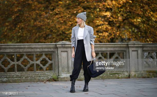 Aylin Koenig wearing Bottega Veneta boots Chanel bag Zara pants By Aylin Koenig blazer and acne studios hat on October 14 2019 in Hamburg Germany