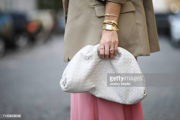 Aylin Koenig wearing Bottega Veneta clutch, Zara skirt, Orseund Iris bra , The Frankie Shop blazer, Dior sneaker and sunglasses and Cartier jewelry...