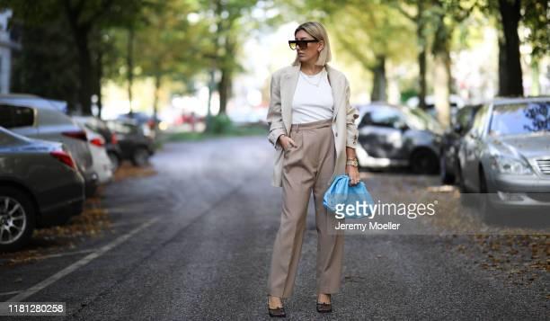 Aylin Koenig wearing Bottega Veneta heels and Pouch bag, By Aylin Koenig blazer, the Frankie Shop pants and Celine sunglasses on October 14, 2019 in...