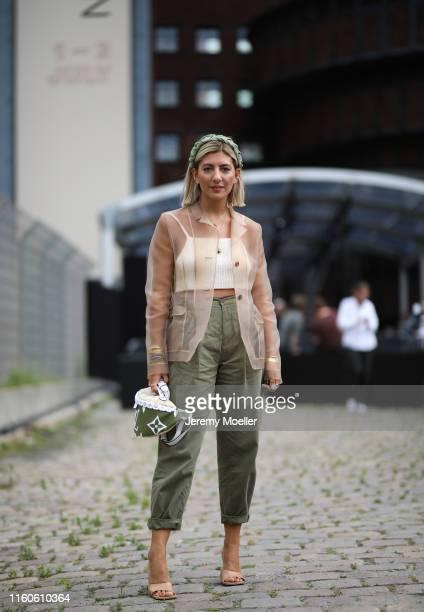 Aylin Koenig wearing Bottega Veneta heels Topshop trousers Miu Miu jacket and Louis Vuitton bumbag on July 01 2019 in Berlin Germany