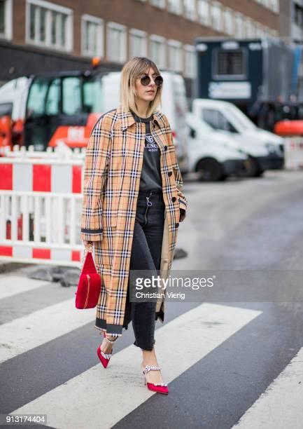 Aylin Koenig wearing Burberry coat Saint Laurent shirt Zara denim jeans Dior heels YSL belt bag during the Copenhagen Fashion Week Autumn/Winter 18...
