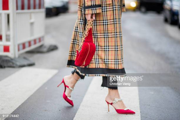 Aylin Koenig wearing Burberry coat Saint Laurent shirt Zara denim jeans Dior heels YSL belt bag during the Copenhagen Fashion Week Autumn/Winter 18...
