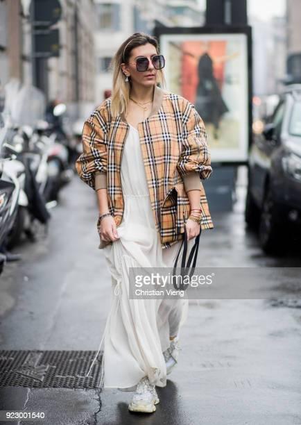 Aylin Koenig wearing Burberry jacket Burberry bag creme white dress seen outside Max Mara during Milan Fashion Week Fall/Winter 2018/19 on February...