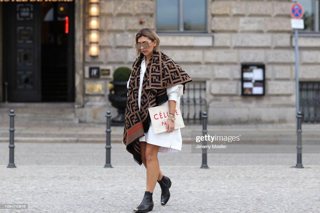 9ec6a9ae1d3 Aylin Koenig wearing Calvin Klein boots, Fendi scarf, Celine clutch ...