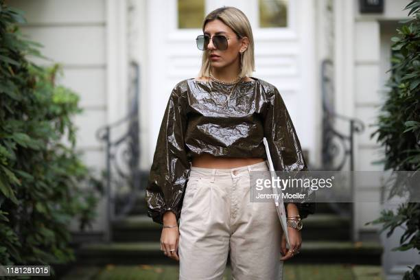 Aylin Koenig wearing Celine clutch, Zara pants and top and Gucci sunglasses on October 14, 2019 in Hamburg, Germany.