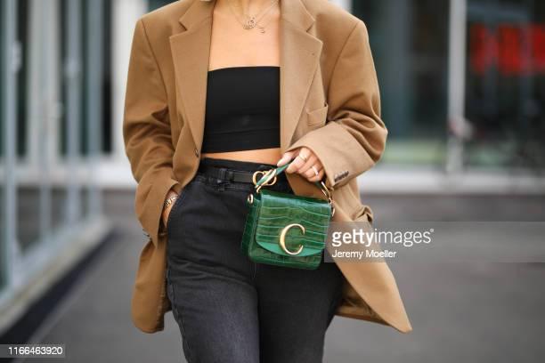 Aylin Koenig wearing Chanel heels, Chloe bag, Zara jeans, Celine sunglasses and Prada hairband on August 06, 2019 in Copenhagen, Denmark.