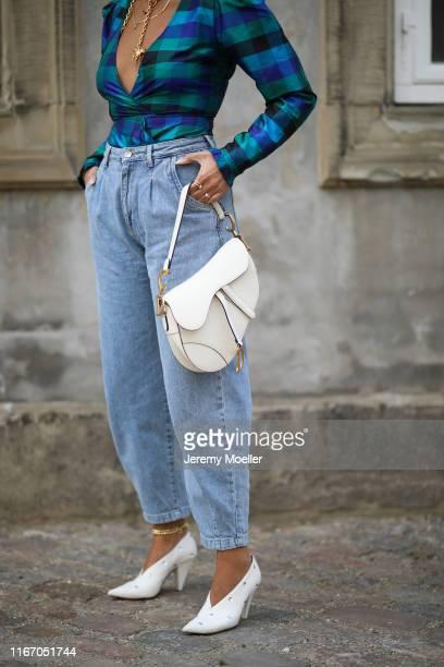 Aylin Koenig wearing Designers Remix blouse, Celine shoes and Dior saddle bag on August 08, 2019 in Copenhagen, Denmark.