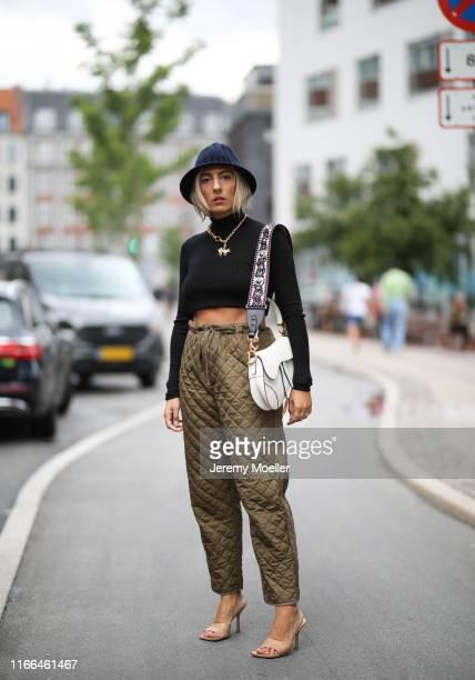Aylin Koenig wearing Dior pants, hat and bag, Bottega Veneta heels on August 06, 2019 in Copenhagen, Denmark.