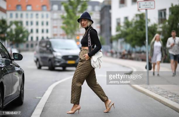 Aylin Koenig wearing Dior pants hat and bag Bottega Veneta heels on August 06 2019 in Copenhagen Denmark
