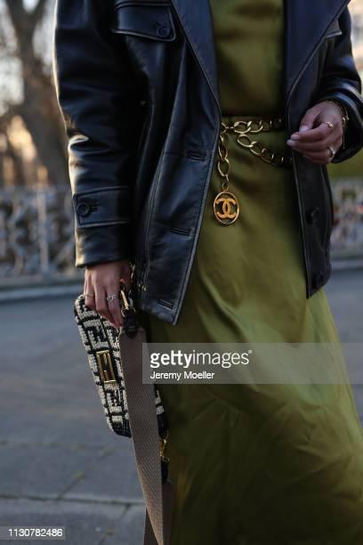 Aylin Koenig wearing Fendi bag Chanel belt Miu Miu leather jacket Cos dress on February 18 2019 in Hamburg Germany