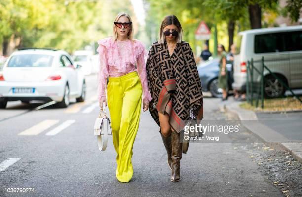 Aylin Koenig wearing Fendi cape Fendi bag and boots and Sonia Lyson wearing yellow pants Rochas pink top Philosophy Gucci bag sunglasses Fendi is...