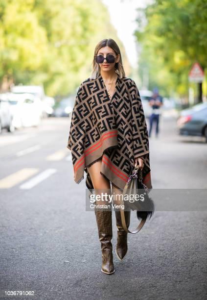 Aylin Koenig wearing Fendi cape Fendi bag and boots is seen outside Fendi during Milan Fashion Week Spring/Summer 2019 on September 20 2018 in Milan...