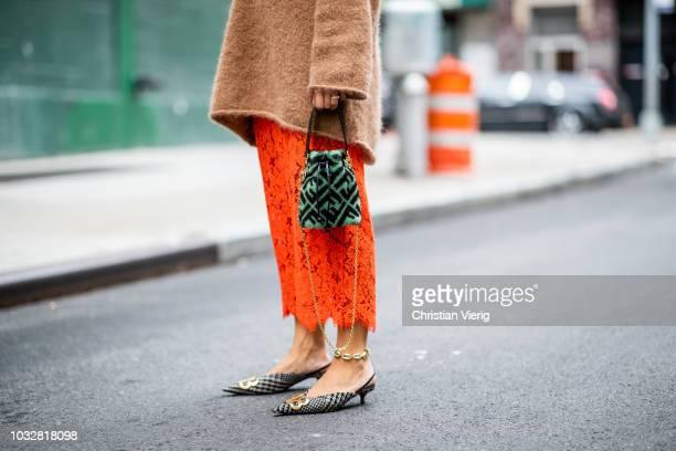 Aylin Koenig wearing Ganni skirt Fendi bag Balenciaga shoes Ganni knit sunglasses Gucci seen during New York Fashion Week Spring/Summer 2019 on...