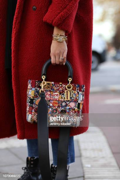 Aylin Koenig wearing HM sweater Topshop jeans Doc Martens Max Mara coat Acne Studios cap and Dior bag on November 26 2018 in Hamburg Germany
