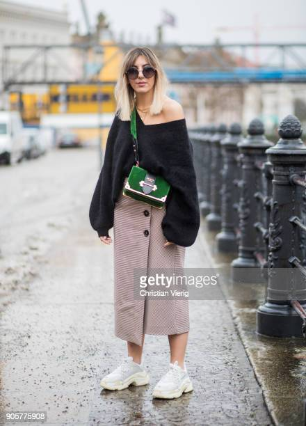Aylin Koenig wearing knit HM Zara skirt Balenciaga sneakers green Prada bag is seen during the Berlin Fashion Week January 2018 at Bauakademie on...
