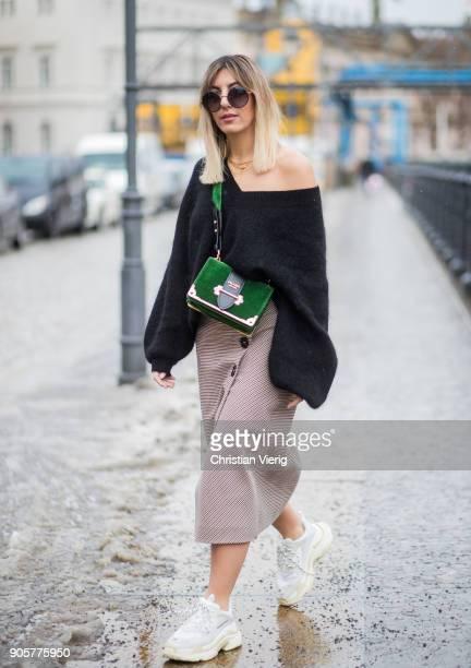 Aylin Koenig wearing knit HM Zara skirt Balenciaga sneakers green Prada bag is seen during the Berlin Fashion Week January 2018 at Bauakademie on...