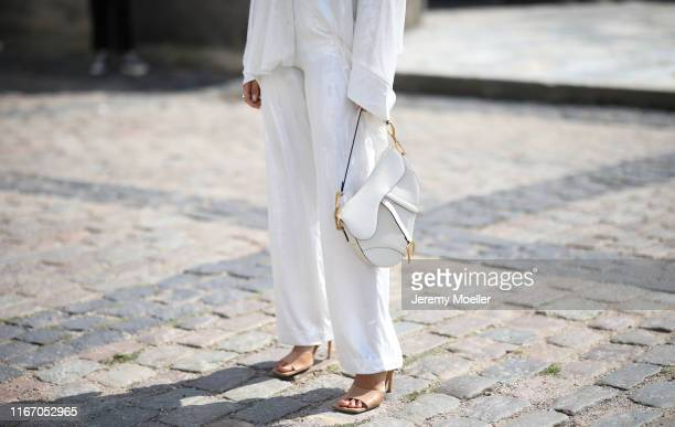 Aylin Koenig wearing Lala Berlin, Dior saddle bag and Bottega Veneta heels on August 08, 2019 in Copenhagen, Denmark.