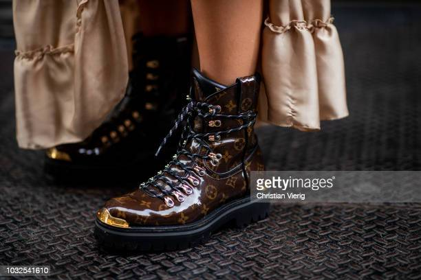 405834036c84 Aylin Koenig wearing Louis Vuitton boots Dior bag and necklace Dolce  Gabbana sunglasses Saint Laurent tshirt