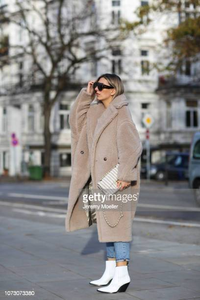 Aylin Koenig wearing Max Mara coat Zara sweater Levi's jeans Iro Paris boots Dior sunglasses and Chanel bag on November 26 2018 in Hamburg Germany