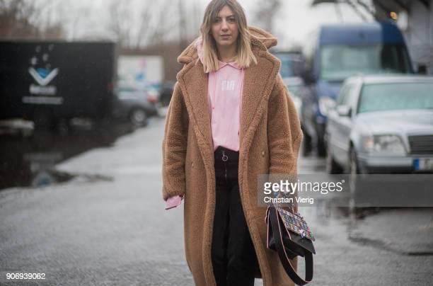 Aylin Koenig wearing Max Mara teddy coat Fendi bag pink hoodie is seen outside Marina Hoermanseder during the Berlin Fashion Week January 2018 on...