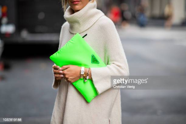 Aylin Koenig wearing neon pink dress H&M Studio collection, Prada neon clutch, Dior necklace, Dolce & Gabbana sunglasses, Mango knit seen during New...