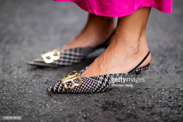 Aylin Koenig wearing neon pink dress HM Studio collection Prada neon clutch Dior necklace Dolce Gabbana sunglasses Mango knit seen during New York...