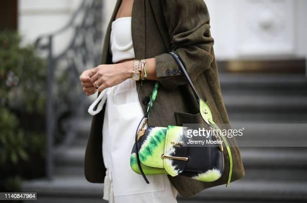 Aylin Koenig wearing Prada batik bag, Zara blazer, Mango pants, Orseund Iris bra and Cartier jewelry on April 06, 2019 in Hamburg, Germany.
