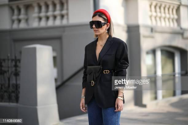 Aylin Koenig wearing Prada hairband Dior belt bag Rooks Rocks blazer Zara jeans Miu Miu pumps Dior sunglasses and Cartier jewelry on April 06 2019 in...