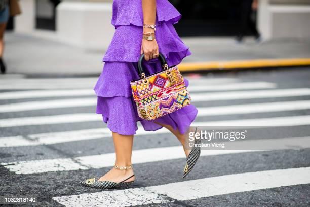 Aylin Koenig wearing purple skirt Baum und Pferdgarten Balenciaga shoes tshirt sunglasses bag Dior is seen during New York Fashion Week Spring/Summer...