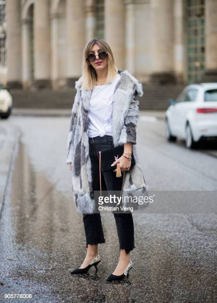 Aylin Koenig wearing Riani shirt Riani coat Dior shoes Zara cropped denim jeans Dolce Gabbana sunglasses Yves Saint Laurent bag is seen during the...