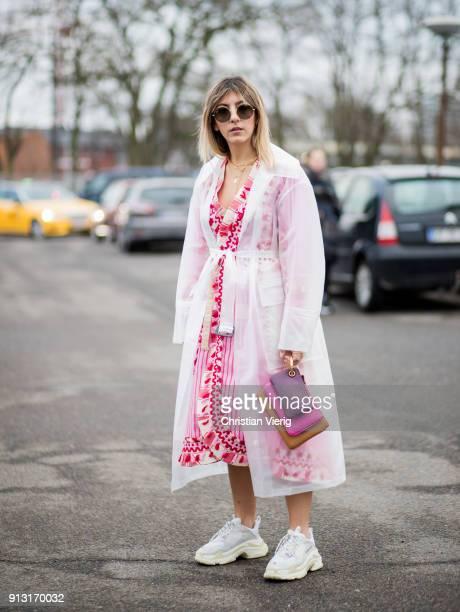 Aylin Koenig wearing sheer rain coat Burberry Dodobaror dress Balenciaga sneaker Fendi bag outside Munthe during the Copenhagen Fashion Week...