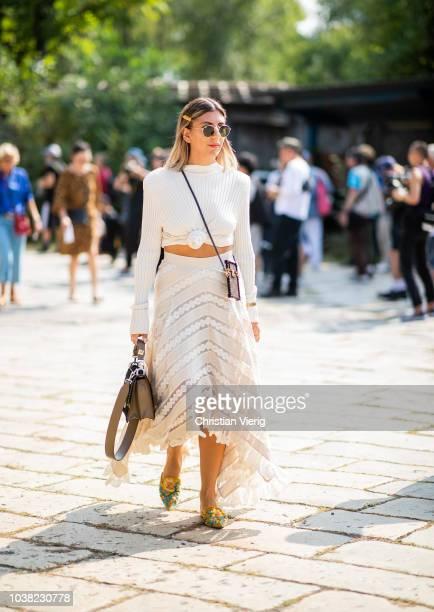 Aylin Koenig wearing skirt and cropped top is seen outside Roberto Cavalli during Milan Fashion Week Spring/Summer 2019 on September 22 2018 in Milan...