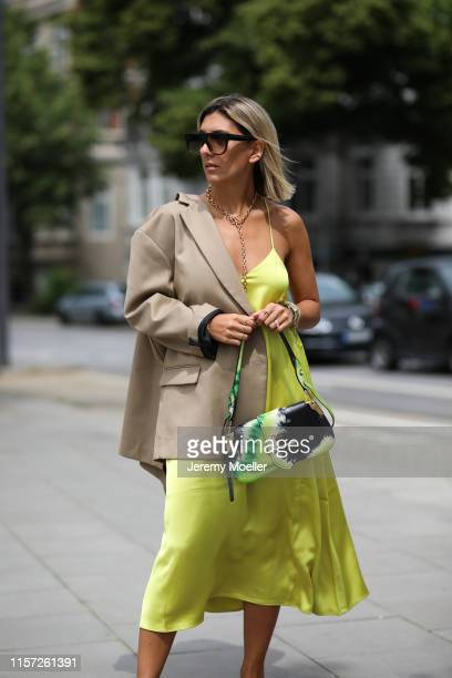 Aylin Koenig wearing The Frankie Shop blazer Chanel shoes Prada bag Arket dress Celine Sunglasses on June 20 2019 in Hamburg Germany