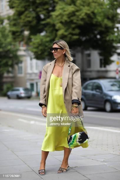 Aylin Koenig wearing The Frankie Shop blazer, Chanel shoes, Prada bag, Arket dress, Celine Sunglasses on June 20, 2019 in Hamburg, Germany.