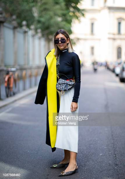 Aylin Koenig wearing turtleneck white skirt Dior saddle bag is seen outside Sportmax during Milan Fashion Week Spring/Summer 2019 on September 21...