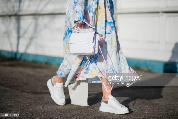 Aylin Koenig wearing Vetements dress Alexander McQueen sneaker Acne beanie Valentino bag during the Copenhagen Fashion Week Autumn/Winter 18 on...
