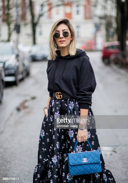 Aylin Koenig wearing white Gucci sneakers blue Chanel bag a navy dress with floral print HM x Erdem a black hoody Asos black Gucci belt Ray Ban...