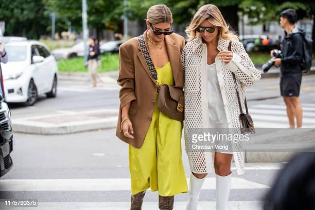 Aylin Koenig wearing yellow dress brown bag Fendi blazer boots with print and Veronica Ferraro wearing white laced coat silk dress boots bag seen...