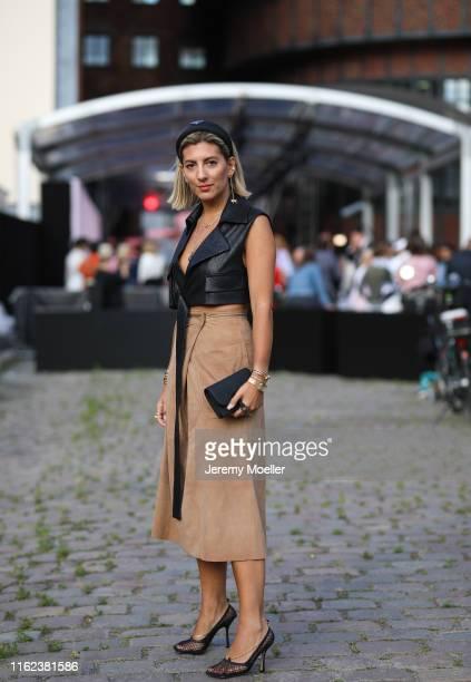 Aylin Koenig wering a Dior bag Bottega Veneta shoes and Riani skirt and top on July 03 2019 in Berlin Germany