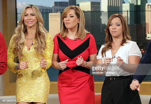 Aylin Mujica Ana Maria Canseco and Adamari Lopez appear on the set of Telemundo's morning show 'Un Nuevo Dia' at Telemundo Studio on November 22 2013...