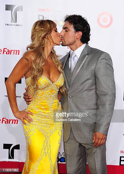 Aylin Mujica and Gabriel Valenzuela arrives at the 2011 Billboard Latin Music Awards at Bank United Center on April 28 2011 in Miami Florida