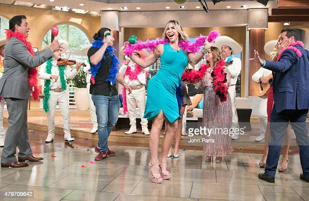 Aylin Mujica dances in the center as Adamari Lopez returns to set of Un Nuevo Dia at Telemundo Studio on July 6 2015 in Miami Florida