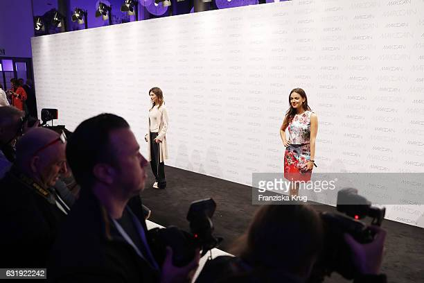 Aylin Tezel and Janina Uhse attend the Marc Cain fashion show A/W 2017 at Deutsche Telekom representation on January 17 2017 in Berlin Germany