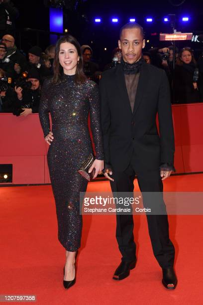 """Aylin Tezel and Jerry Hoffmann arrive for the opening ceremony and """"My Salinger Year"""" premiere during the 70th Berlinale International Film Festival..."""